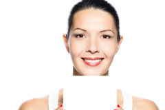 Beautiful young woman holding a blank card Stock Photography