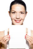 Beautiful young woman holding a blank card Royalty Free Stock Photo
