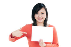 Beautiful young woman holding blank note card Stock Image