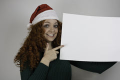 Beautiful young woman holding blank sign Royalty Free Stock Image