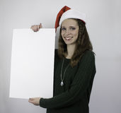 Beautiful young woman holding blank sign Royalty Free Stock Photos