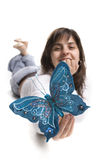 Beautiful young woman holding blue butterfly Stock Image
