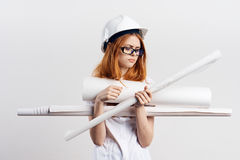 Beautiful young woman holding blueprints on white isolated background, engineer, building.  Stock Photos