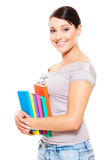 Beautiful young woman holding books Royalty Free Stock Images