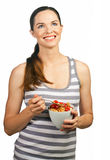 Beautiful young woman holding a bowl of cereal Royalty Free Stock Photography
