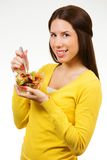 Beautiful young woman, holding bowl of salad and smiling Royalty Free Stock Image