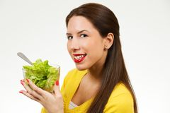 Beautiful young woman, holding bowl of salad and smiling Royalty Free Stock Photos