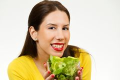 Beautiful young woman, holding bowl of salad and smiling Royalty Free Stock Images