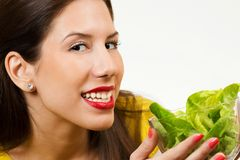Beautiful young woman, holding bowl of salad and smiling Stock Photography