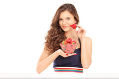 Beautiful young woman holding a bowl of strawberries Royalty Free Stock Photos