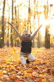 Beautiful young woman holding a bunch of autumn leaves. Young woman in autumn park stock photos
