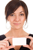 Beautiful young woman holding business card Royalty Free Stock Images