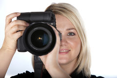 Beautiful Young Woman Holding Camera. Gorgeous Young Female Photographer Holding Camera on White Isolated Background Royalty Free Stock Image