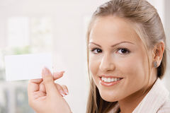 Beautiful young woman holding card Royalty Free Stock Photo