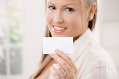 Beautiful young woman holding card Royalty Free Stock Photography