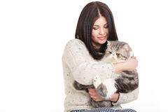 Beautiful young woman holding a cat, isolated against white background Stock Photo