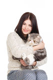Beautiful young woman holding a cat, isolated against white background Stock Image