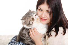 Beautiful young woman holding a cat, isolated against white background Stock Photos