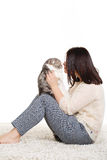 Beautiful young woman holding a cat, isolated against white background Royalty Free Stock Photos