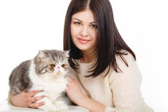 Beautiful young woman holding a cat, isolated against white background Royalty Free Stock Photography