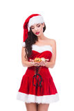 Beautiful young woman holding Christmas balls. Isolated. Xmas and New Year preparation Royalty Free Stock Photo