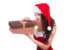 Beautiful young woman holding Christmas gift Stock Images