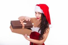 Beautiful young woman holding Christmas gift Stock Image
