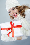 Beautiful young woman holding Christmas present Royalty Free Stock Images