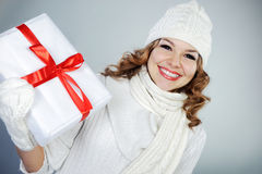 Beautiful young woman holding Christmas present Stock Photos