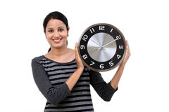 Beautiful young woman holding clock Royalty Free Stock Images
