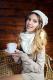 Beautiful young woman holding a coffee cup Stock Image