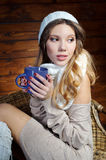 Beautiful young woman holding a coffee cup Stock Images
