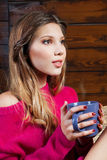 Beautiful young woman holding a coffee cup Royalty Free Stock Photos