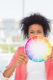 Beautiful young woman holding color wheel Stock Photo