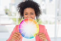 Beautiful young woman holding color wheel Royalty Free Stock Photos