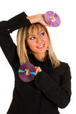 Beautiful young woman holding compact disc Royalty Free Stock Photo