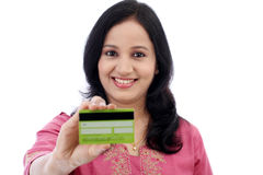 Beautiful young woman holding credit card Royalty Free Stock Photo
