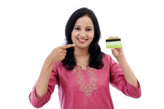 Beautiful young woman holding credit card Royalty Free Stock Photos