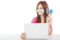 Free Beautiful Young Woman Holding Credit Card With Laptop Royalty Free Stock Photography - 29082237