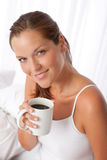 Beautiful young woman holding cup of coffee royalty free stock image