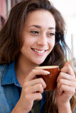 Beautiful young woman holding cup of coffee Royalty Free Stock Photo