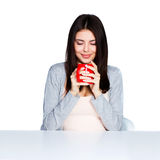 Beautiful young woman holding a cup of her favorite beverage Royalty Free Stock Images