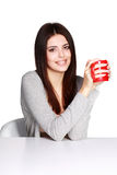 Beautiful young woman holding a cup of her favorite beverage Stock Photos