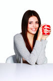 Beautiful young woman holding a cup of her favorite beverage Stock Photo