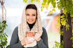 Beautiful young woman holding a cup of tea Stock Photos