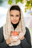 Beautiful young woman holding a cup of tea Royalty Free Stock Photos