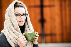 Beautiful young woman holding a cup of tea Royalty Free Stock Photography