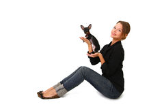Beautiful young woman holding a cute little dog isolated Royalty Free Stock Photos
