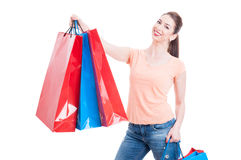 Beautiful young woman holding few shopping bags and smiling Royalty Free Stock Photography