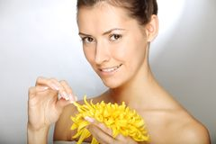 Beautiful young woman holding flower Royalty Free Stock Photo